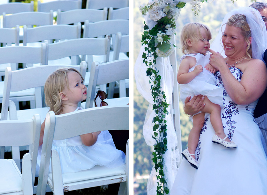 Mom bride with her baby daughter in outdoor wedding